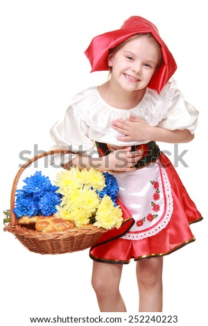 Emotional girl in a beautiful red dress and hat, holding a basket of cakes and chrysanthemums/Adorable happy little girl dressed as a red cap with a basket of pies on Holiday - stock photo