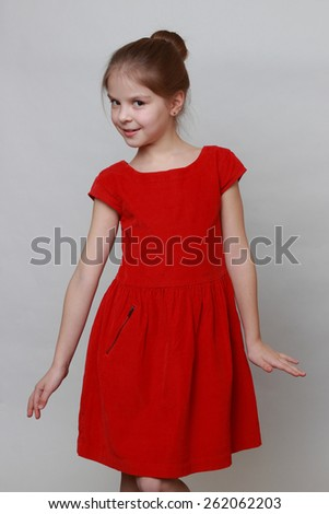 Emotional girl wearing fashion red dress and dancing - stock photo