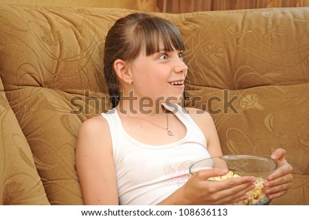 emotional girl with popcorn - stock photo