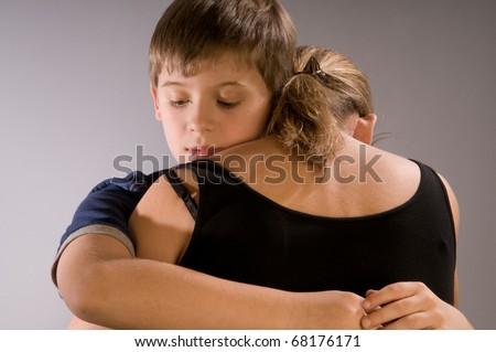 Emotional hug, boy with his mom - stock photo