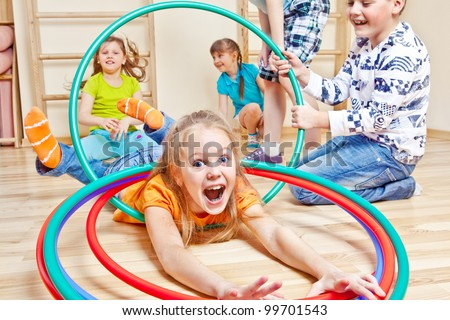 Emotional kids having fun in gym - stock photo