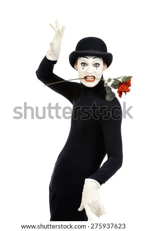 Emotional male mime artist with red rose performing love. Isolated over white. - stock photo