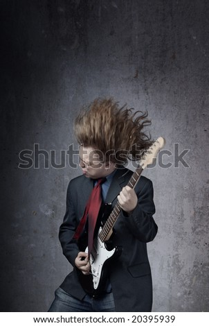 Emotional photo of the man playing electric guitar - stock photo