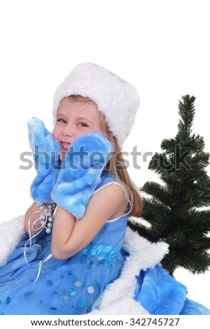 Emotional portrait of a cheerful girl in blue dress. New Year soon - stock photo