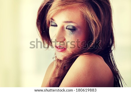 Emotional portrait of abused, crying, beautiful, young ,caucasian woman in underwear - violence concept - stock photo