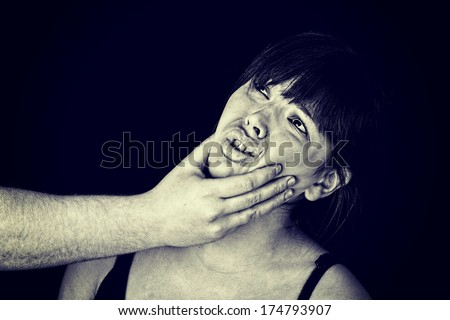 Emotional portrait of abused woman - stock photo