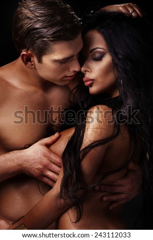 Emotional portrait of attractive couple. Handsome man and sexy woman posing together. - stock photo