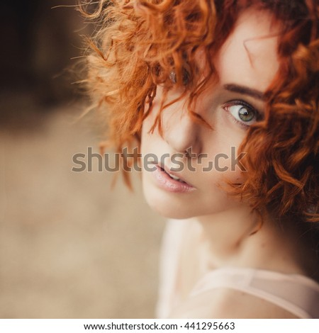 emotional portrait of Fashion stylish portrait of pretty young hipster ginger woman,going crazy,elegant black hat,soft colors,cool crazy girl.Red urban wall background.surprised girl close up - stock photo