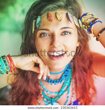 "Emotional portrait of pretty hippie girl wearing handmade jewelry (""instagram"" style filter applied) - stock photo"