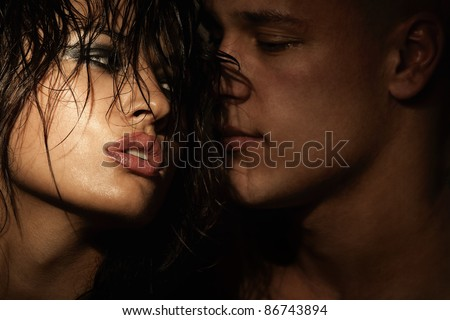 Emotional sexy scene - passionate embraces - stock photo