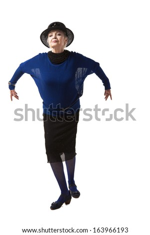 emotional woman posing with raised hands in studio, wearing clothes in retro style - stock photo