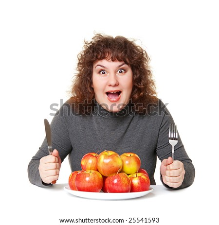 emotional woman with apples against white background - stock photo