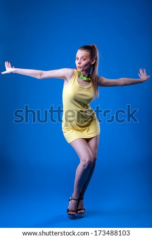 Emotional young girl posing with bright uv makeup - stock photo