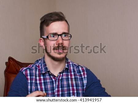 emotions Disappointed Man. Guy feel dissappointment. Boy sit on chair. - stock photo