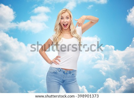 emotions, expressions, advertisement and people concept - happy smiling young woman or teenage girl in white t-shirt pointing finger to herself over blue sky and clouds background - stock photo