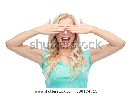 emotions, expressions and people concept - smiling young woman or teenage girl covering her eyes with palms - stock photo