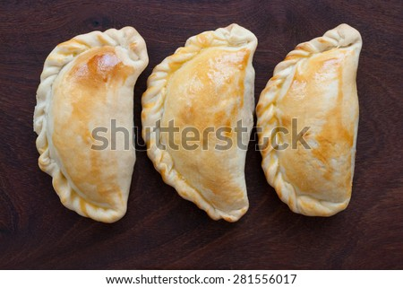 empanada - southamerican traditional food  on wooden background - stock photo