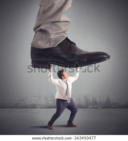 Employed crushed by his boss at work - stock photo