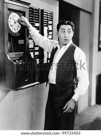 Employee changing time clock - stock photo