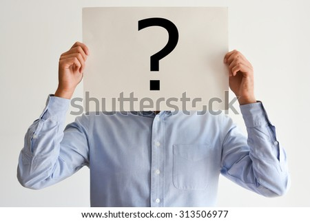 Employee dilemma with question marks on blank paper - stock photo