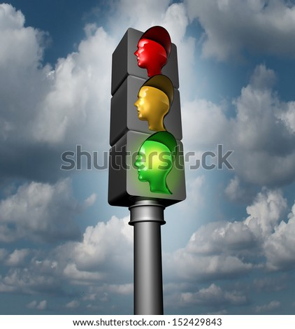 Employee guidance and human direction as a business and career concept as traffic lights with red yellow and a glowing bright green go lamp shaped as human heads for illuminating a  success journey. - stock photo