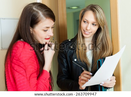 employee polling among people at home  door. Focus on blonde - stock photo