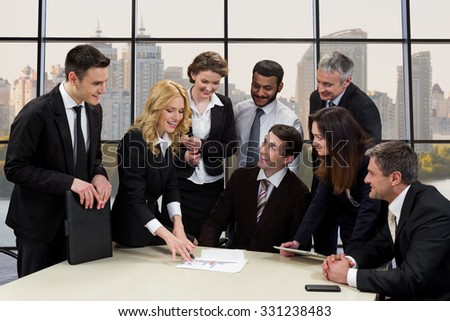 Employees of business company. Business woman presents a construction project colleagues. Business corporation. - stock photo
