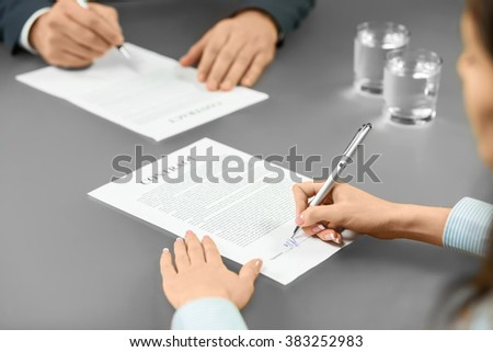 Employer and worker sign contracts. An important step. Common goals build good progress. The decision is yours. - stock photo