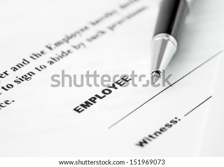 Employment contract and pen ready to sign it  - stock photo