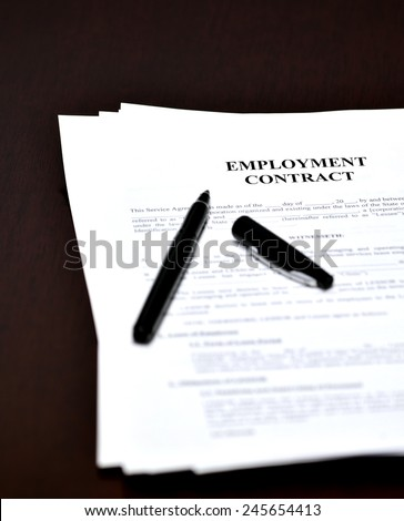 Employment Contract document and agreement with pen for signing - stock photo