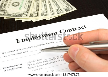 employment contract with dollar, hand and pen for signature - stock photo