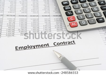 employment contract with numbers, calculator and pen - stock photo
