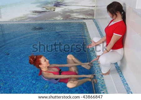 Employment with the pregnant woman in pool - stock photo