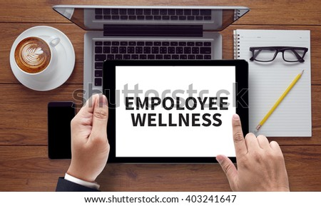 EMPOLOYEE WELLNESS , on the tablet pc screen held by businessman hands - online, top view - stock photo