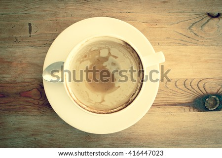 Empty a cup of Latte Coffee art on the wooden desk.Filtered Vintage tone. - stock photo