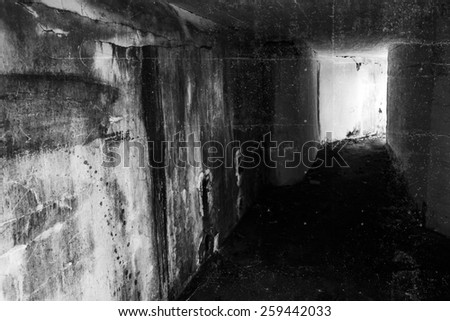 Empty abandoned bunker interior with glowing end of dark corridor, green toning photo filter effect - stock photo