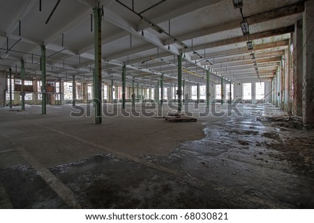 empty abandoned warehouse hall - stock photo
