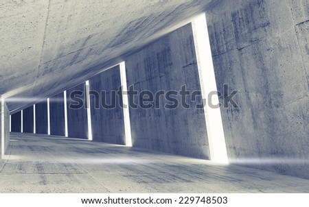 Empty abstract concrete tunnel interior with tall windows and lights - stock photo