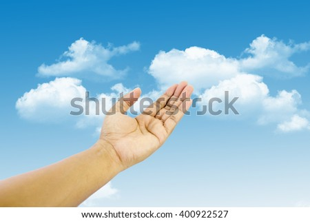 empty adult man hand on blue sky background - stock photo