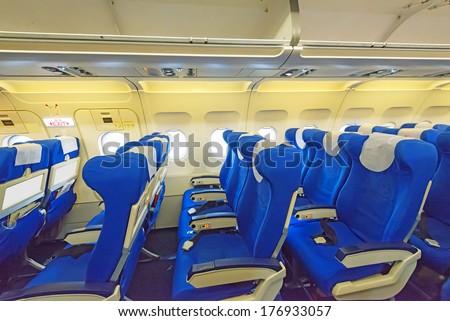 Empty aircraft seats and windows - stock photo