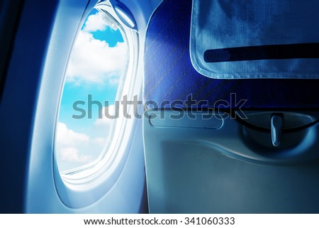 Empty aircraft seats and windows. - stock photo