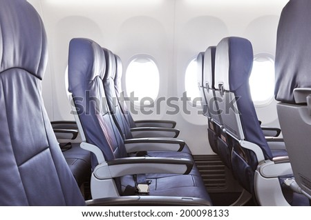 Empty airplane seats - stock photo
