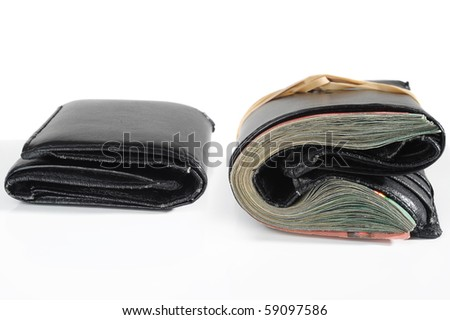 Empty and full wallet on white background - stock photo