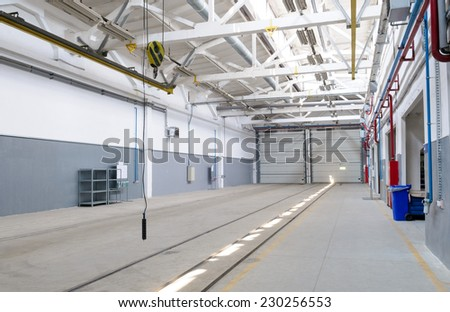 empty and huge industrial warehouse interior - stock photo