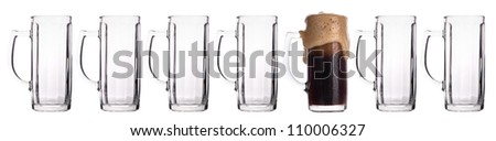 empty and one full beer glass isolated on a white background - stock photo