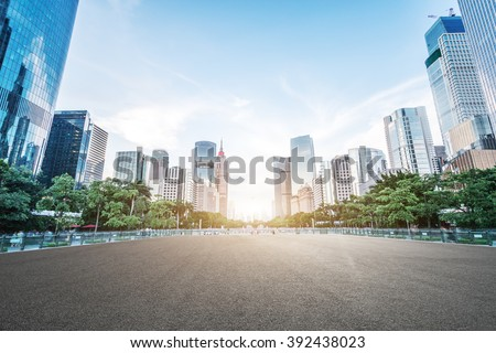 empty asphalt road and modern buildings in guangzhou - stock photo