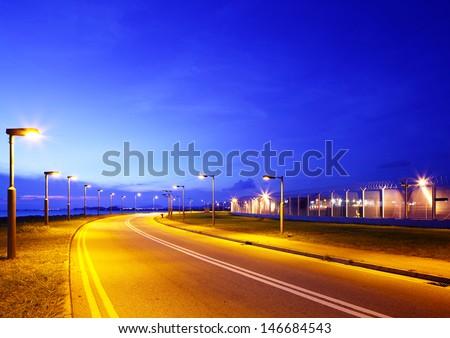 Empty asphalt road at night - stock photo
