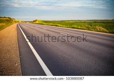 empty asphalt road in countryside - stock photo