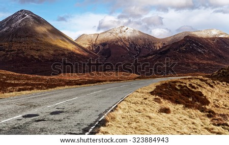 Empty asphalt road in high mountains - stock photo
