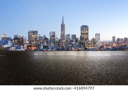 empty asphalt road with cityscape and skyline of san francisco - stock photo